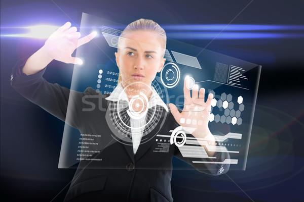 Mujer de negocios tocar interfaz compuesto digital ordenador Foto stock © wavebreak_media
