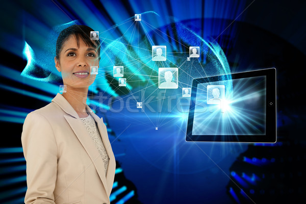 Businesswoman with profile icons and tablet Stock photo © wavebreak_media