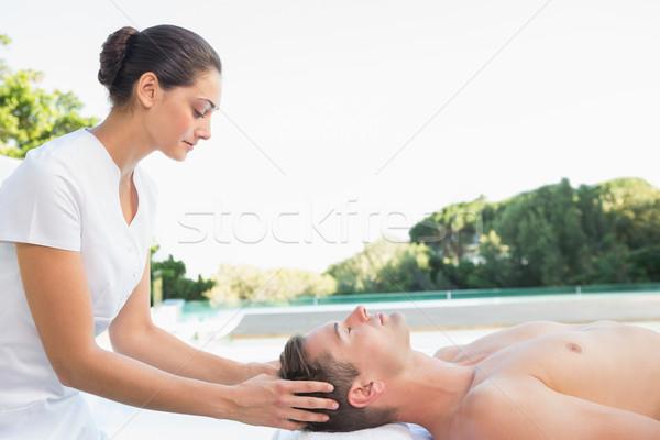 Paisible homme tête massage à l'extérieur spa Photo stock © wavebreak_media