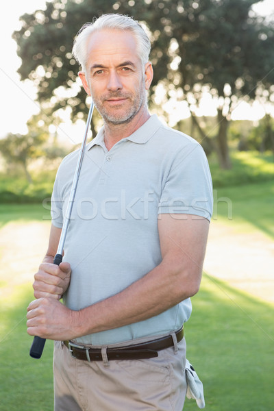 Smiling handsome golfer looking at camera Stock photo © wavebreak_media