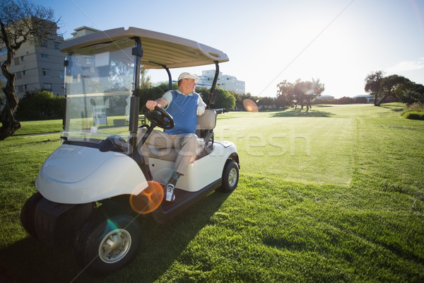 Golfer reversing his golf buggy Stock photo © wavebreak_media