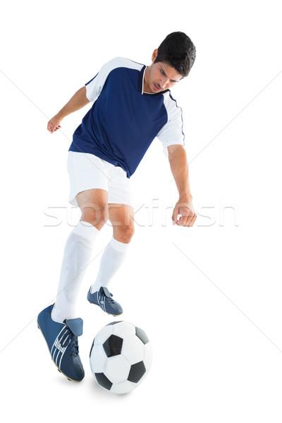 Futballista kék rúg labda fehér sport Stock fotó © wavebreak_media