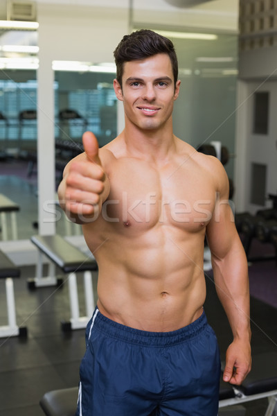 Shirtless muscular man giving thumbs up in gym Stock photo © wavebreak_media
