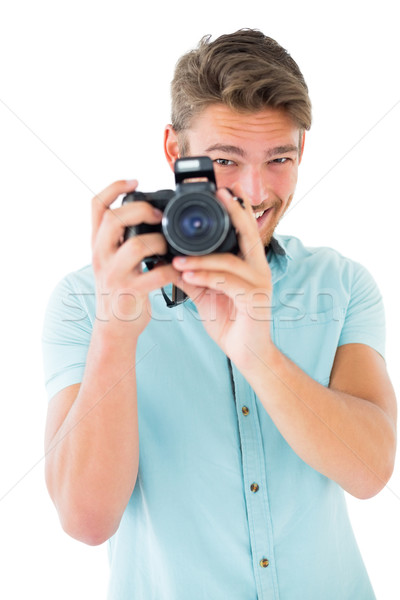 Knap jonge man digitale camera witte gelukkig Stockfoto © wavebreak_media