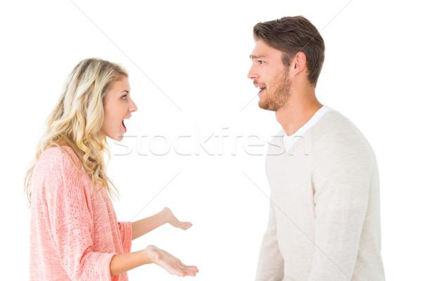 Attractive couple talking about something shocking Stock photo © wavebreak_media