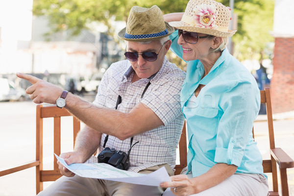 Happy tourist couple looking at map in the city Stock photo © wavebreak_media
