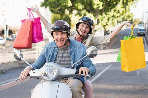 Boldog érett pár lovaglás moped város Stock fotó © wavebreak_media