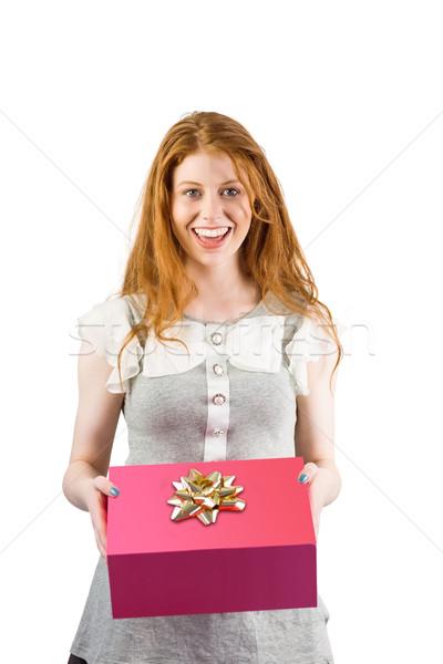 Bella offrendo scatola regalo bianco felice Foto d'archivio © wavebreak_media