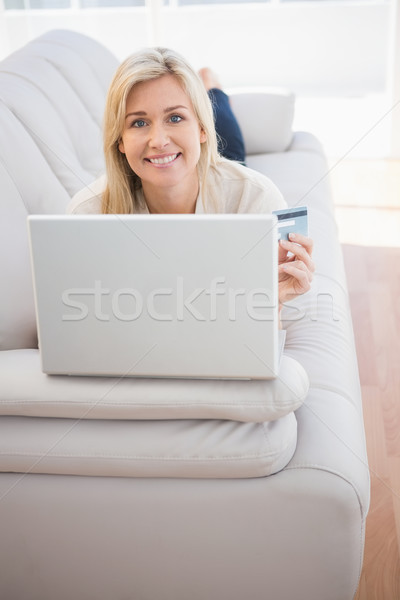 Pretty blonde shopping online with laptop Stock photo © wavebreak_media
