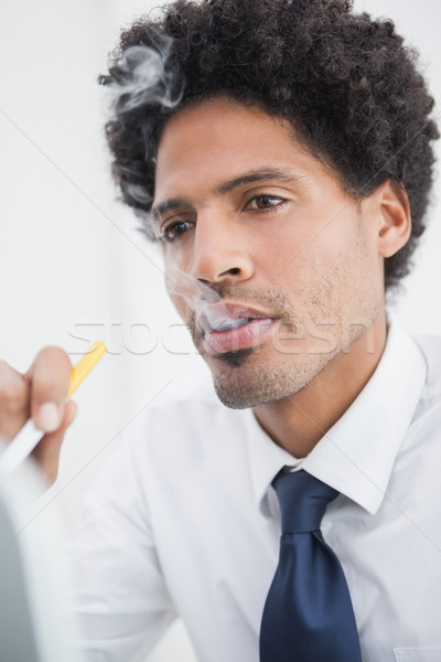 Portrait of a businessman smoking  Stock photo © wavebreak_media