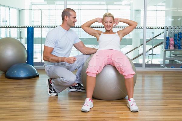 Homme entraîneur femme abdominale gymnase Photo stock © wavebreak_media