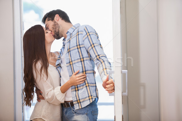 Young couple kiss as they open front door Stock photo © wavebreak_media