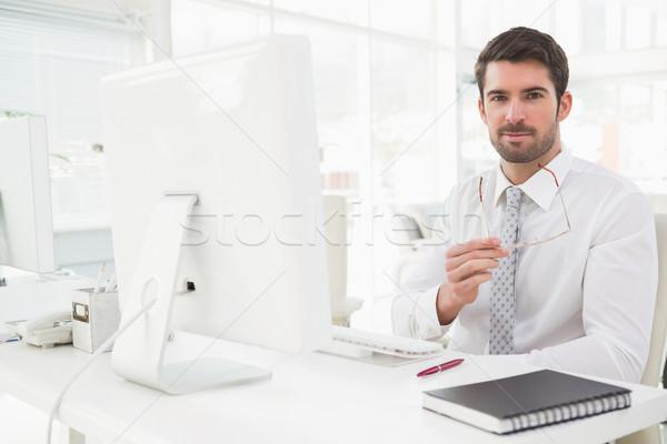 Mosolyog üzletember jólöltözött ül iroda számítógép Stock fotó © wavebreak_media