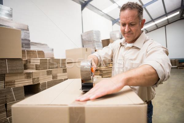 Entrepôt travailleur affaires boîte Photo stock © wavebreak_media