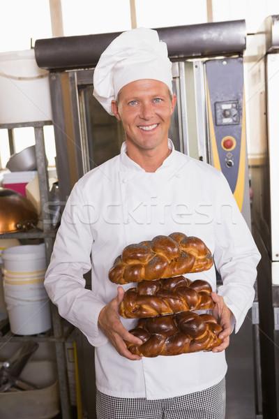 улыбаясь Бейкер свежие кухне хлебобулочные Сток-фото © wavebreak_media