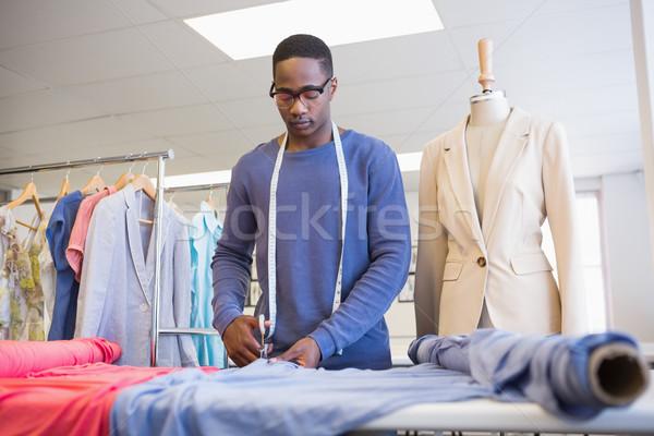 University student cutting fabric with a pair of scissors Stock photo © wavebreak_media