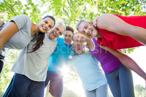 Felice gruppo guardando verso il basso fotocamera Foto d'archivio © wavebreak_media