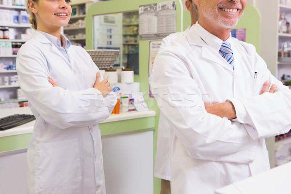 Sorridere farmacista apprendista braccia incrociate farmacia donna Foto d'archivio © wavebreak_media