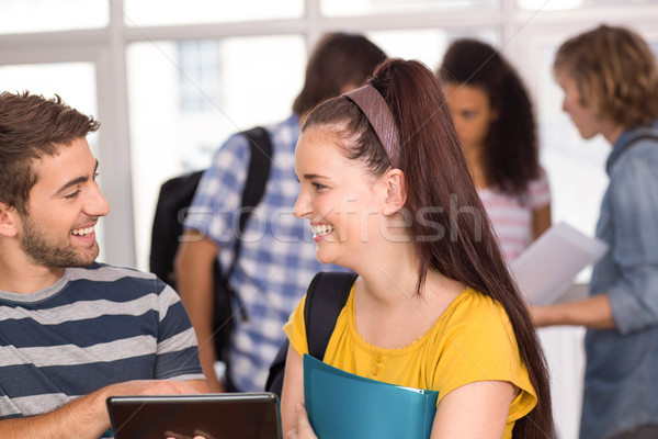 Smiling students using digital tablet Stock photo © wavebreak_media