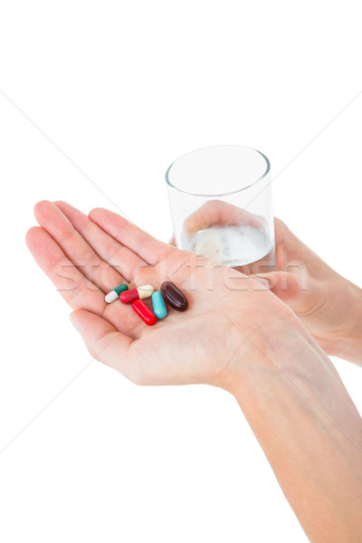 Nő tart halom tabletták üveg víz Stock fotó © wavebreak_media
