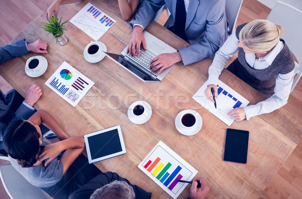 Business team discussing the graphs  Stock photo © wavebreak_media