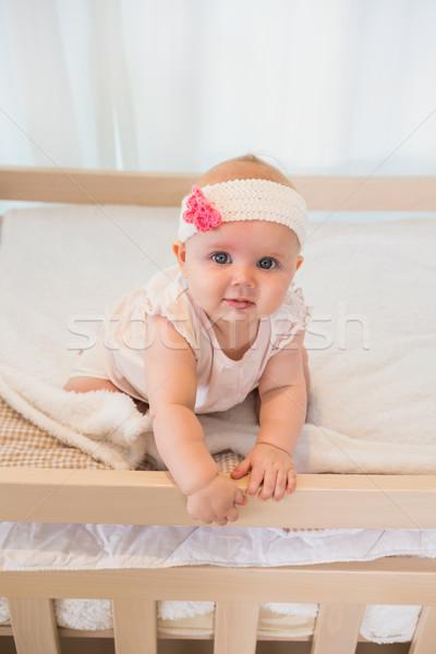 Beautiful baby girl in his bed Stock photo © wavebreak_media