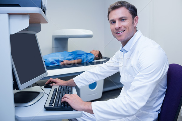 Portrait of a smiling doctor in radiography room Stock photo © wavebreak_media