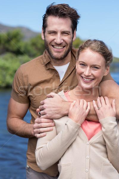 Happy couple at a lake Stock photo © wavebreak_media