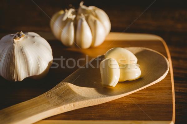 Zdjęcia stock: Czosnku · żarówki · deska · do · krojenia · kopia · przestrzeń · kuchnia