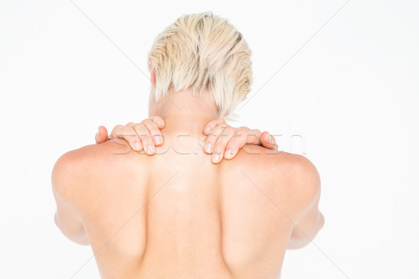 Hermosa top-less mujer tocar cuello blanco Foto stock © wavebreak_media