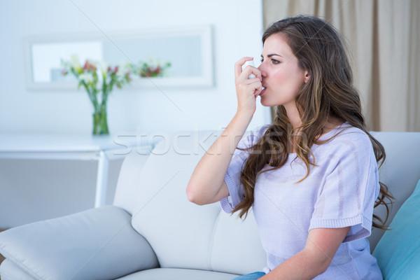 Pretty woman taking her inhaler  Stock photo © wavebreak_media