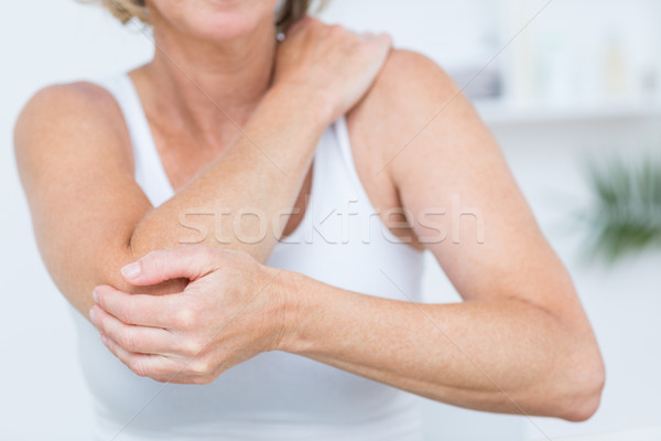 Mulher cotovelo dor médico escritório corpo Foto stock © wavebreak_media
