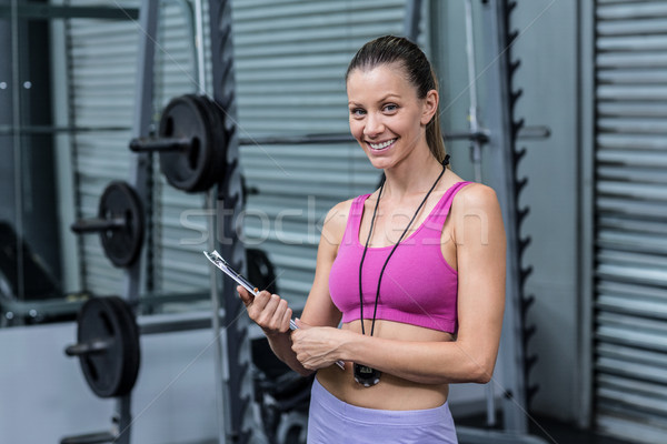 Smiling female coach with a clipboard and stopwatch Stock photo © wavebreak_media