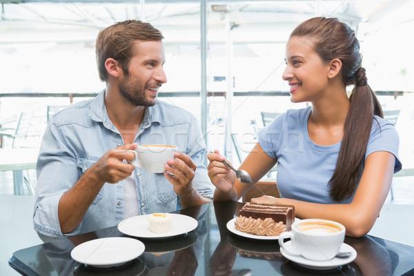 Young happy couple eating cake  Stock photo © wavebreak_media