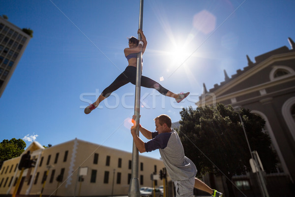 Extreme athletes hanging on street sign  Stock photo © wavebreak_media