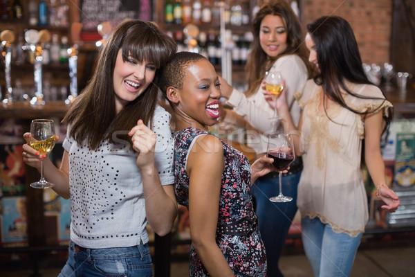 Female friends enjoying at pub Stock photo © wavebreak_media