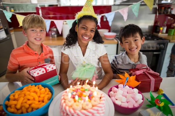 Portrait of siblings celebrating birthday in kitchen Stock photo © wavebreak_media