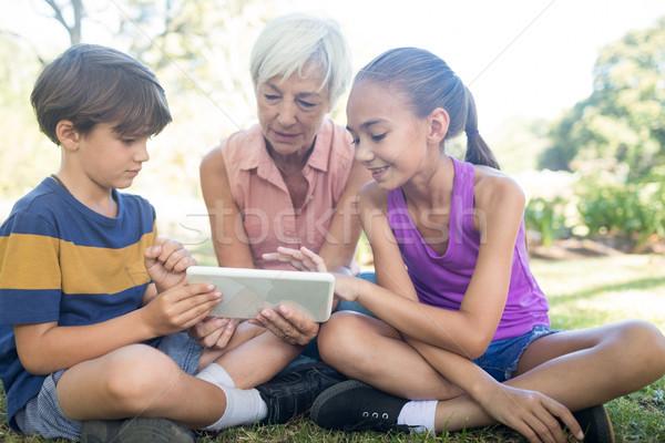 Grandmother and grand kids using digital tablet in the park Stock photo © wavebreak_media