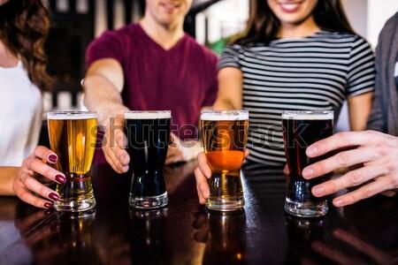 Vrolijk vrienden bier samen discotheek Stockfoto © wavebreak_media