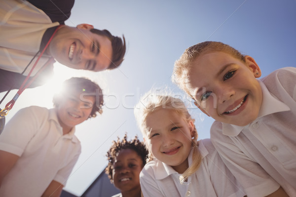 Portrait of smiling coach and schoolkids Stock photo © wavebreak_media