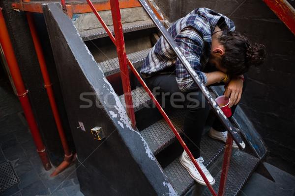 Részeg férfi ül lépcsőház bár üveg Stock fotó © wavebreak_media