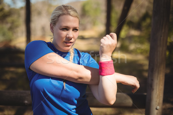 Beautiful woman performing stretching exercise during obstacle course Stock photo © wavebreak_media