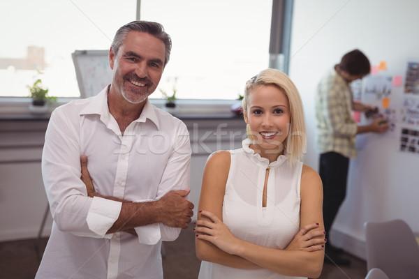 улыбаясь бизнесмен деловая женщина Постоянный Creative служба Сток-фото © wavebreak_media