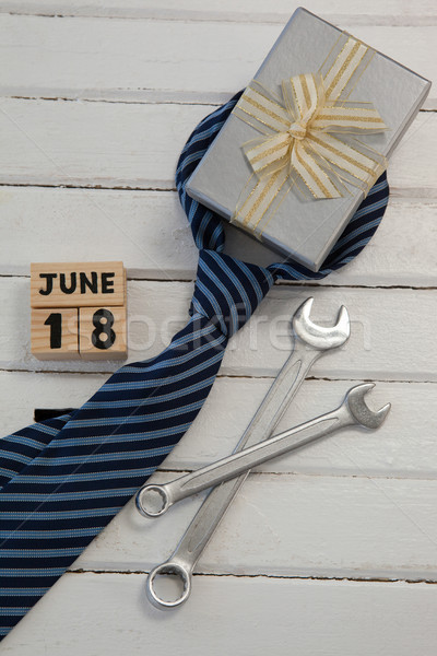 Various gifts and date arranged on wooden table Stock photo © wavebreak_media