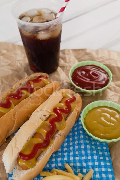 Hot dog bevanda fredda carta marrone primo piano piatto carne Foto d'archivio © wavebreak_media
