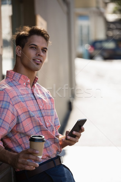 Young man looking away while leaning on wall Stock photo © wavebreak_media