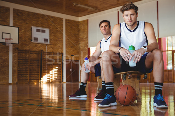 Portrait of confident basketball players sitting on bench Stock photo © wavebreak_media