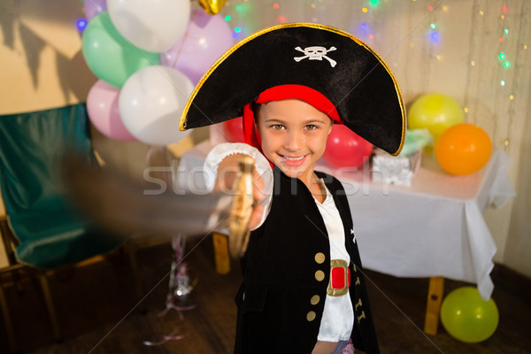 Boy pretending to be as pirate during birthday party Stock photo © wavebreak_media
