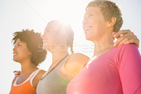 Smiling sporty women looking far away Stock photo © wavebreak_media