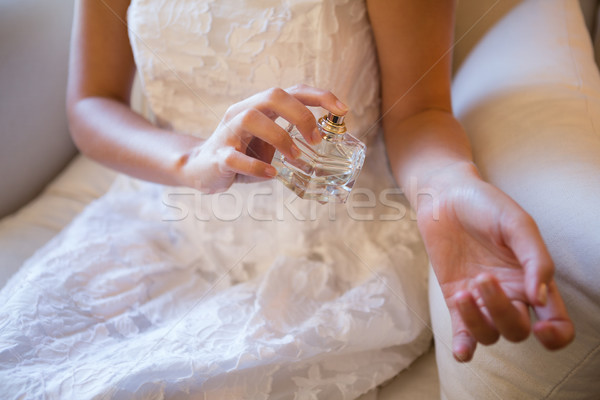 Midsection of bride spraying perfume on hand Stock photo © wavebreak_media
